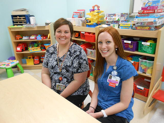 Jodi Miles, left, and Jacquelyn MacLeod sit at a child's activity desk May 10, 2015, in the playroom of the Summerlin Hospital pediatrics unit. The plethora of toys behind them sit ready for any c ...
