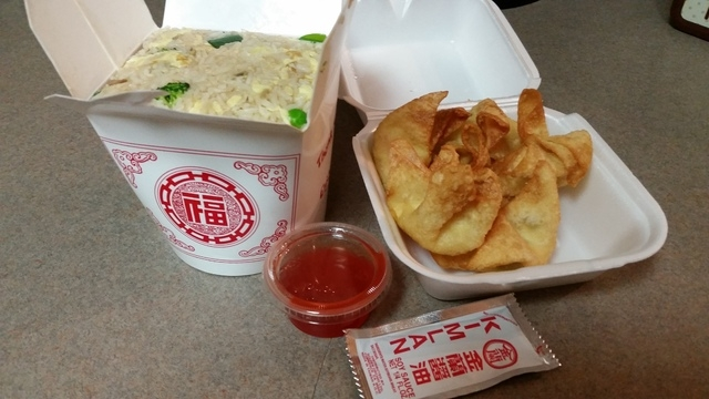 A take-out order of vegetable fried rice and crab Rangoon from China A Go Go is shown. (Lisa Valentine/View)