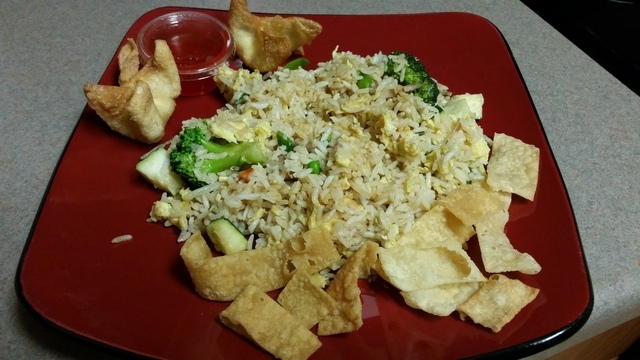 Vegetable fried rice and crab Rangoon from China A Go Go is shown plated.