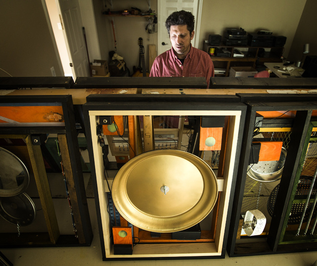 "Artist David Sanchez Burr with his ""Citizen Speak"" project at his home studio in downtown  Las Vegas on Friday, April 10, 2015. His work  which includes musical instruments and microphon ..."