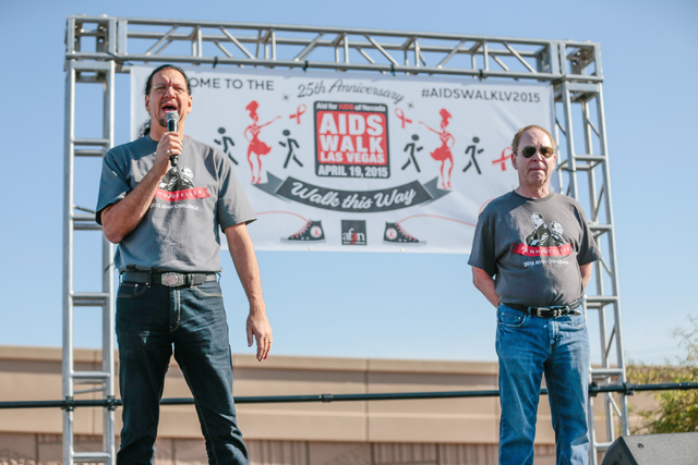 Penn Jillette, left, speaks to the crowd as Raymond Teller looks on, prior to the start of the Aid for AIDS of Nevada (AFAN) 25th Annual AIDS Walk Las Vegas at Town Square Las Vegas, South Las Veg ...