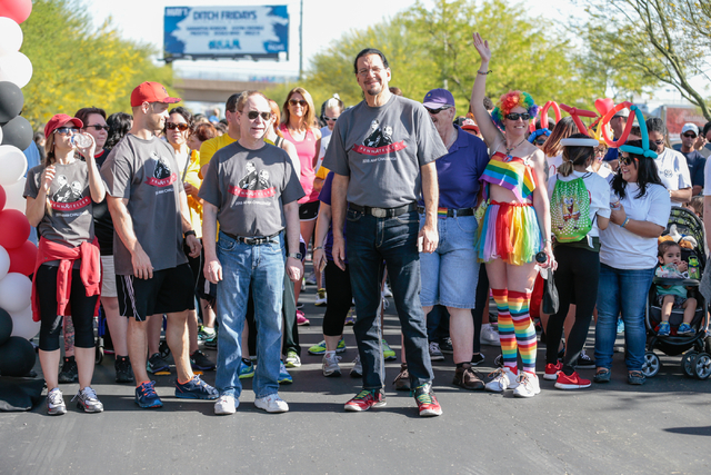 Raymond Teller , front left, along with Penn Jillette wait for the start of the Aid for AIDS of Nevada (AFAN) 25th Annual AIDS Walk Las Vegas at Town Square Las Vegas, South Las Vegas Boulevard,   ...