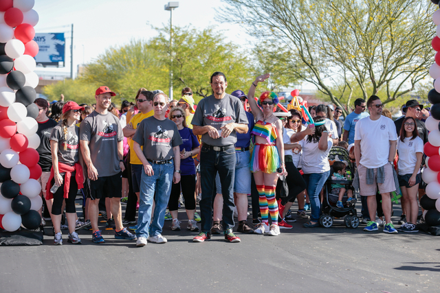 Raymond Teller , front left, along with Penn Jillette, center, wait with other particpants for the start of the Aid for AIDS of Nevada (AFAN) 25th Annual AIDS Walk Las Vegas at Town Square Las Veg ...
