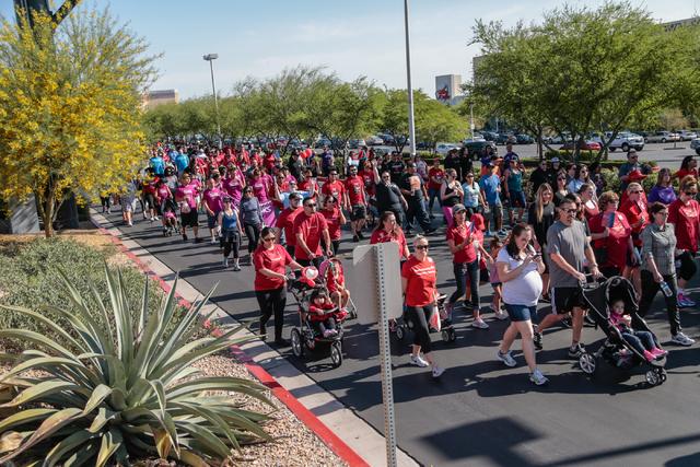 Participants walk the course during the Aid for AIDS of Nevada (AFAN) 25th Annual AIDS Walk Las Vegas at Town Square Las Vegas, South Las Vegas Boulevard,  Las Vegas, Sunday, April 19, 2015. (Dona ...