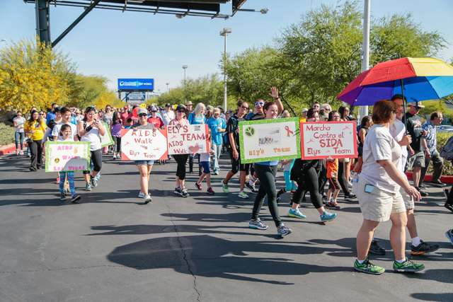Participants carrying team signs, walk the course during the Aid for AIDS of Nevada (AFAN) 25th Annual AIDS Walk Las Vegas at Town Square Las Vegas, South Las Vegas Boulevard,  Las Vegas, Sunday,  ...