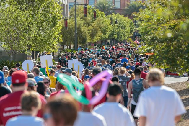 A large crowd of participants walk the course during the Aid for AIDS of Nevada (AFAN) 25th Annual AIDS Walk Las Vegas at Town Square Las Vegas, South Las Vegas Boulevard,  Las Vegas, Sunday, Apri ...