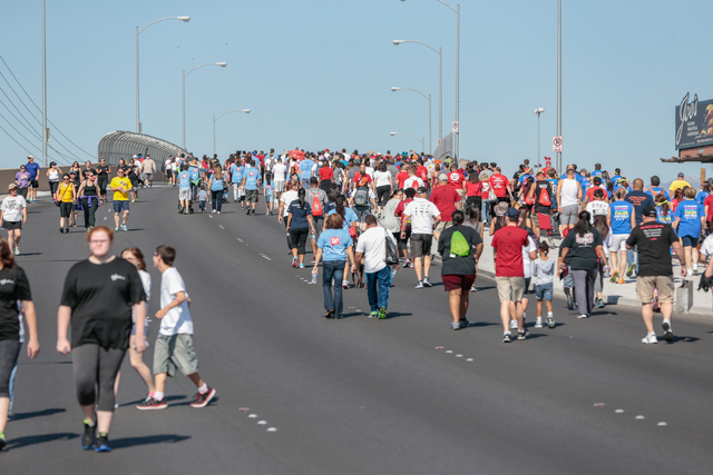 A crowd of participants walk across the overpass on W. Sunset road as part of the course for the Aid for AIDS of Nevada (AFAN) hosts the 25th Annual AIDS Walk Las Vegas at Town Square Las Vegas, S ...