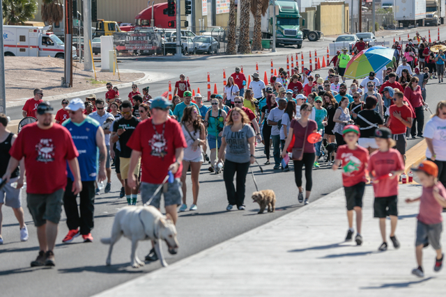 A crowd of participants walk  on West Sunset road as part of the course for the Aid for AIDS of Nevada (AFAN) hosts the 25th Annual AIDS Walk Las Vegas at Town Square Las Vegas, South Las Vegas Bo ...