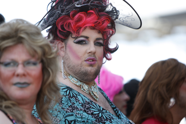 Chris Sanders, center, in costume as a drag queen looks on during the Guinness World Records largest drag queen stage show event at Hard Rock Cafe in Las Vegas Sunday, April 12, 2015. (Erik Verduz ...