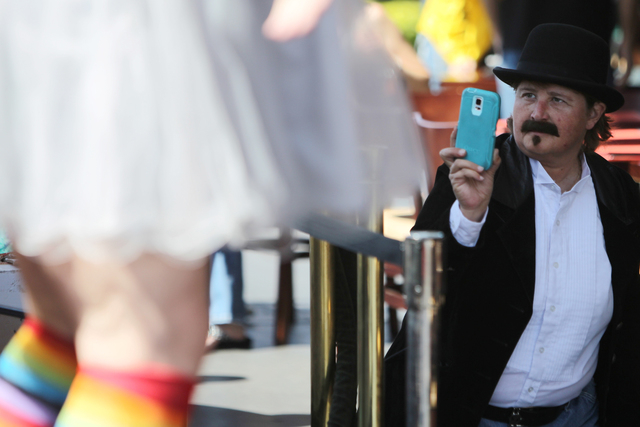 Janeen Peasley in costume as a drag king takes photos of his friend during the Guinness World Records largest drag queen stage show event at Hard Rock Cafe in Las Vegas Sunday, April 12, 2015.  (E ...