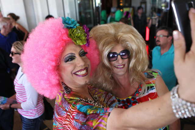 Nick Cenimo, left, and Russell Landsdown, in costume as a drag queens, take a photo together during the Guinness World Records largest drag queen stage show event at Hard Rock Cafe in Las Vegas Su ...