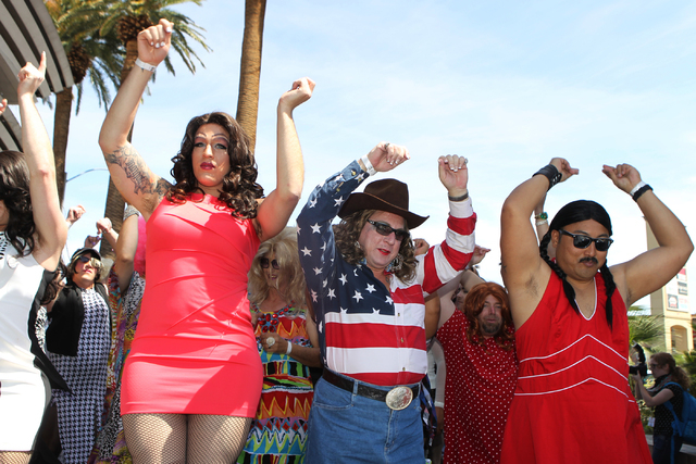 Adam Gordon, from left, Ken Wells, and Dan Duenas, in costume as a drag queens, dance for the Guinness World Records largest drag queen stage show during an event at Hard Rock Cafe in Las Vegas Su ...