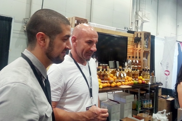 Seth Benhaim, left, and Steve Lipp of Infuse Spirits of Las Vegas talk Tuesday, March 31, 2015, at their booth at the Nightclub Convention and Bar Show at the Las Vegas Convention Center. (Steve M ...