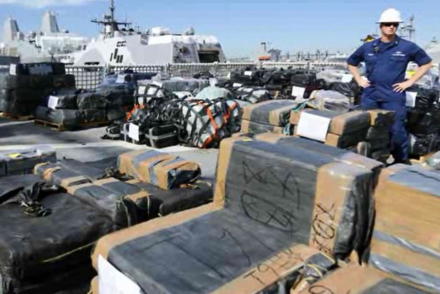 The crew of the U.S. Coast Guard Cutter Boutwell unloaded more than 14 tons of cocaine on a San Diego dock Thursday, April 16, 2015.(Screengrab/Inform)
