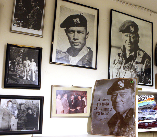 "Photos and other memorabilia hang in the garage of retired U.S. Army Col. Bill Olds in his Las Vegas home, Monday, March 21, 2011, from when Olds appeared in the classic John Wayne movie ""The Gree ..."