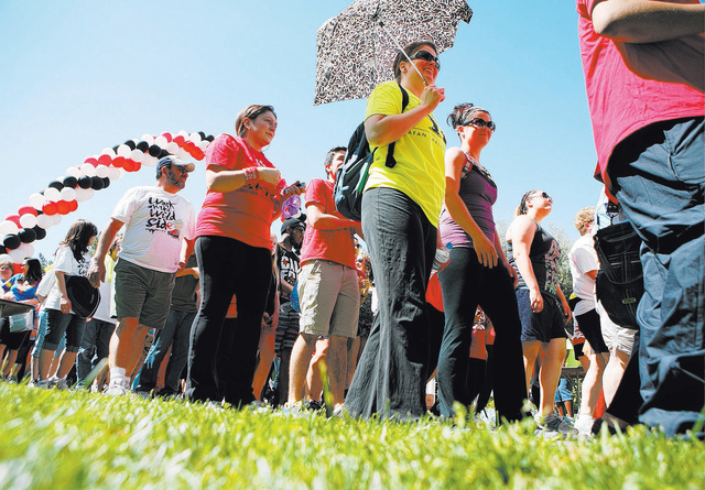 People walk at the start of Aid for AIDS of Nevada's 23rd annual AIDS Walk at UNLV April 14, 2013. This year's walk is scheduled for April 19 at Town Square Las Vegas, 6605 Las Vegas Blvd. South.  ...