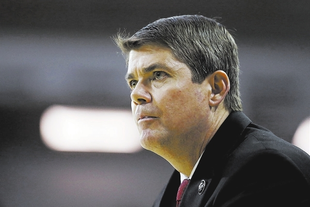 Feb 24, 2015; Logan, UT, USA; UNLV Rebels head coach Dave Rice keeps an eye on the game against the Utah State Aggies at Dee Glen Smith Spectrum. Mandatory Credit: Jeff Swinger-USA TODAY Sports