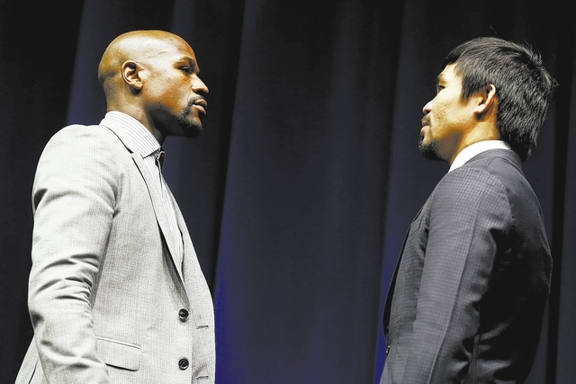 "Eleven-time, five-division world boxing champion Floyd ""Money"" Mayweather (L) and eight-division world champion Manny ""Pac-Man"" Pacquiao attend a press conference  in Los Angel ..."