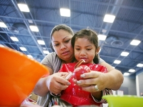 Laura Vazquez and her daughter Miranda, 4, peel an apple during a Little Books and Little Cooks class at Cortez Elementary School, 4245 E. Tonopah Ave., in 2013. The free class, sponsored by Unive ...