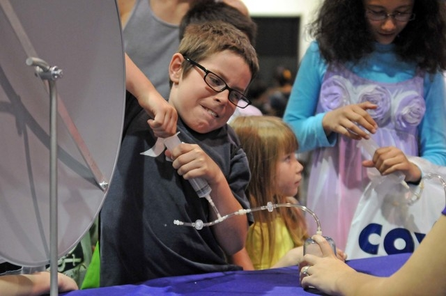 Nicholas Thompson, 10, pulls a syringe May 7, 2011, at the inaugural Las Vegas Science Festival Expo at Cashman Center. The syringe connected to a small capsule containing a marshmallow, which exp ...