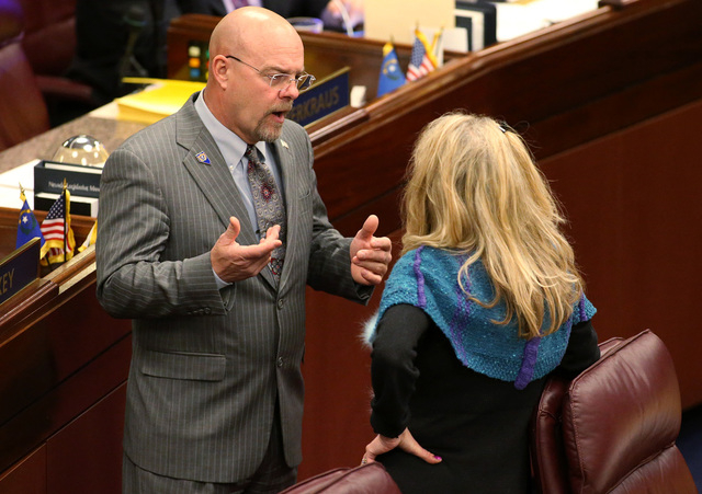 Nevada Assembly Republicans Ira Hansen and Jill Dickman talk on the Assembly floor at the Legislative Building in Carson City, Nev., on Tuesday, April 14, 2015. Hansen and a subset of ultra-conser ...
