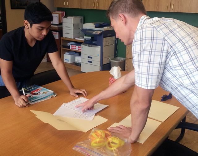 Zack Sanderson, right, works with a student taking part in the driving school education component at Adam's Place for Grief in 2014. The grief center was established after founder Kelly Thomas  ...