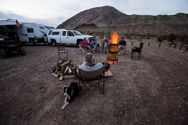 Stormy the dog lays beside Ted Brown, at Gold Butte area on Thursday, May 22, 2014. The Gold Butte Region, administered by the BLM and the U.S. National Park Service, is located about 2-1/2 hours  ...
