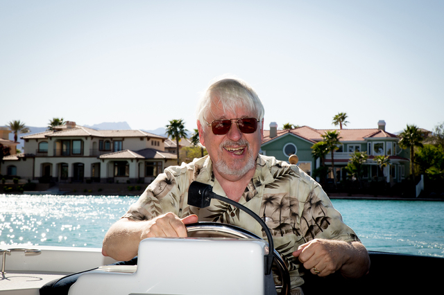 Tonya Harvey/Real Estate Millions  David Fordham takes his electric  boat for a ride on Lake Sahara.