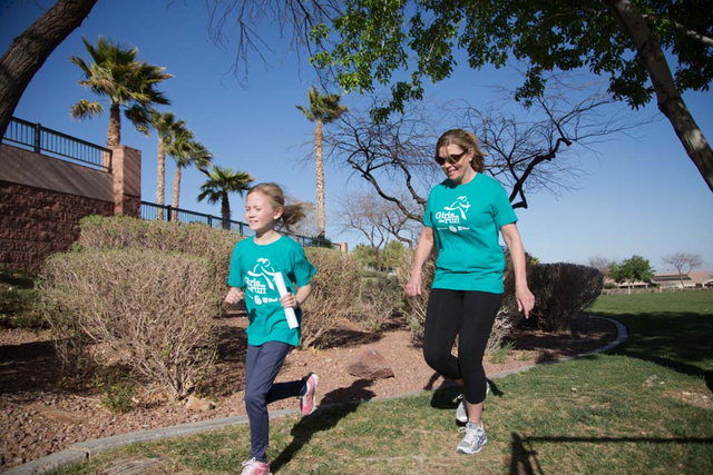 Coach Teri Heinz encourages Hannah Mallon as they run at Tree Top Park, 600 Sageberry Drive, in this undated photo as part of the Girls on the Run program. Girls on the Run plans to host its sprin ...