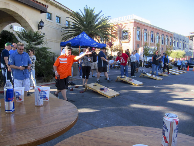 Contestants line up to take their best shot Nov. 15 during the Turkey Toss Cornhole Tournament at Made L.V in Tivoli Village, 450 S. Rampart Blvd. Made L.V. plans to host the Spring Fling Cornhole ...