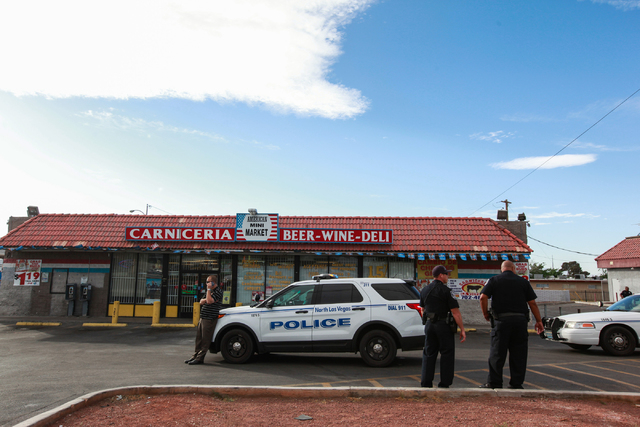 North Las Vegas police investigate the scene of a shooting that left one person in critical condition in the 2500 block of Las Vegas Boulevard North on Tuesday, April 14, 2015. Police have a suspe ...