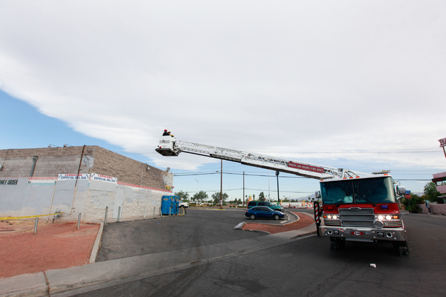 North Las Vegas police investigate the scene of a shooting with the assistance of the North Las Vegas Fire Department in the 2500 block of Las Vegas Boulevard North on Tuesday, April 14, 2015. The ...