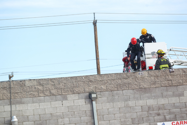 North Las Vegas police investigate the scene of a shooting  with the assistance of the North Las Vegas Fire Department at the 2500 block of Las Vegas Boulevard North on Tuesday, April 14, 2015. Th ...