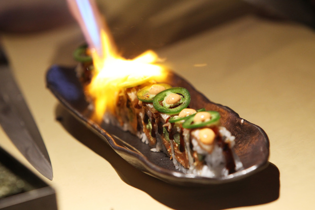 The Secret Weapon roll has a flame applied at Lucky Foo's April 10, 2015. (Sam Morris/Las Vegas Review-Journal)