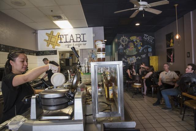 Mae Pineda, left, makes waffles at Tiabi Coffee & Waffle Bar April 10, 2015. (Martin S. Fuentes/View)