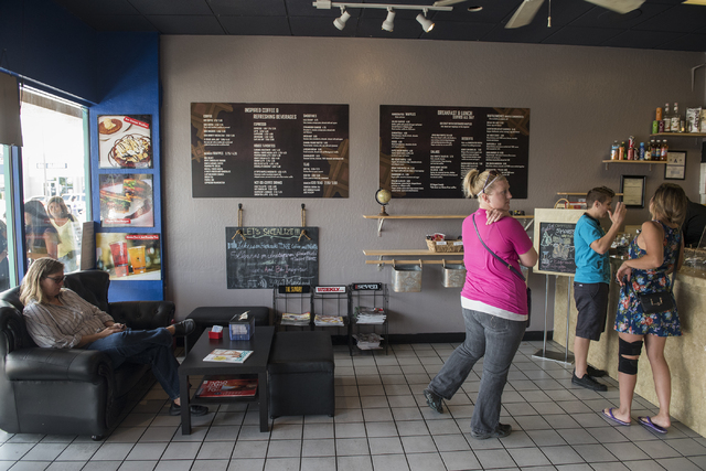Customers wait to order at Tiabi Coffee & Waffle Bar April 10, 2015. (Martin S. Fuentes/View)
