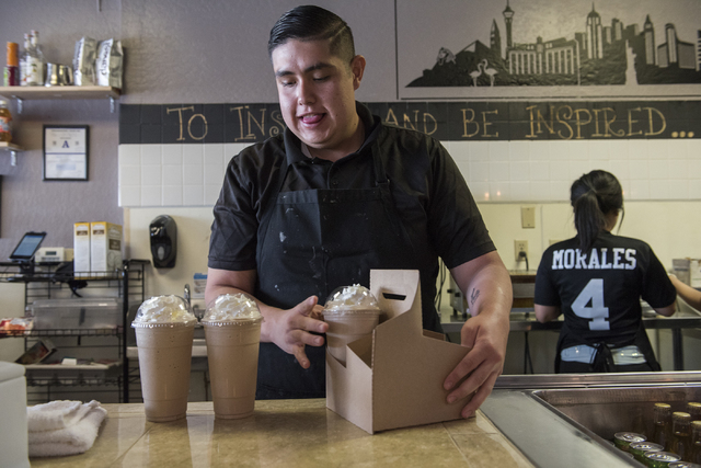 Adrian Cornejo packs up frappes at Tiabi Coffee & Waffle Bar April 10, 2015. (Martin S. Fuentes/View)