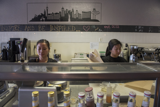Mae Pineda, left, and Jessica Morales make waffles at Tiabi Coffee & Waffle Bar April 10, 2015. (Martin S. Fuentes/View)