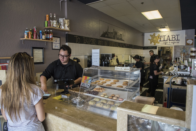 Jonathan Lueck, left, takes an order from a customer at Tiabi Coffee & Waffle Bar April 10, 2015. (Martin S. Fuentes/View)