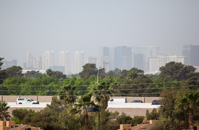 Traffic moves along on U.S. Highway 95 near Boulder Highway as the Strip is seen partially obscured by dust in the background  in Las Vegas on Wednesday, April 1, 2015. (Chase Stevens/Las Vegas Re ...