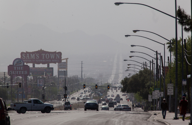 A view of Boulder Highway looking south is seen partially obscured by dust in the background in Las Vegas on Wednesday, April 1, 2015. The Clark County Department of Air Quality issued a dust advi ...
