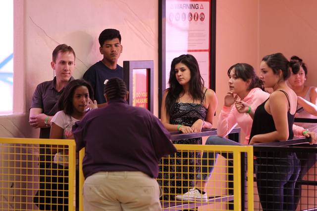 Riders wait to ride El Loco roller coaster inside the Adventuredome theme park at Circus Circus casino-hotel in Las Vegas Wednesday, April 22, 2015. El Loco is celebrating their one year anniversa ...