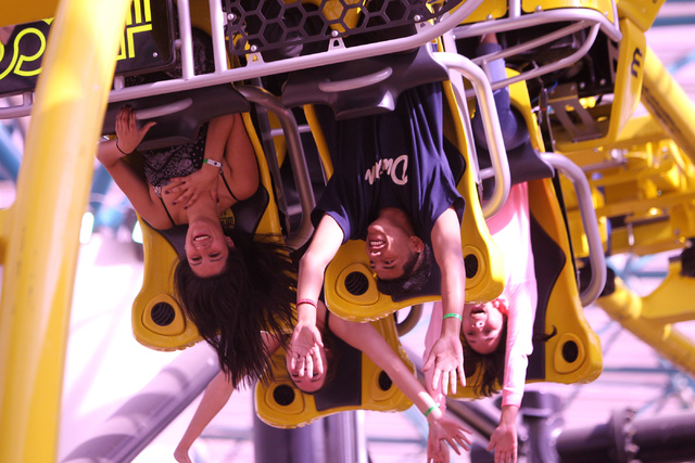 Melissa Alatorre, 17, clockwise from left, with her boyfriend Jonathan Flores, 16, and her twin sisters Darlene, 15, and Kristine, ride El Loco roller coaster inside the Adventuredome theme park a ...