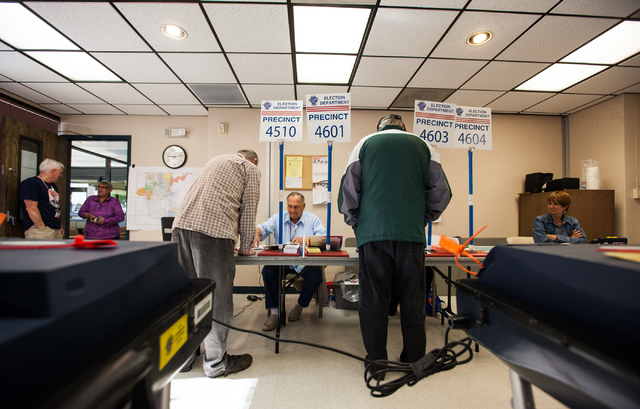 Glen Dunning, third from left, and Don Bechard, fifth from left, check in to vote for the municipal election at the Las Vegas Senior Center at 451 E. Bonanza Road in Las Vegas on Tuesday, April 7, ...
