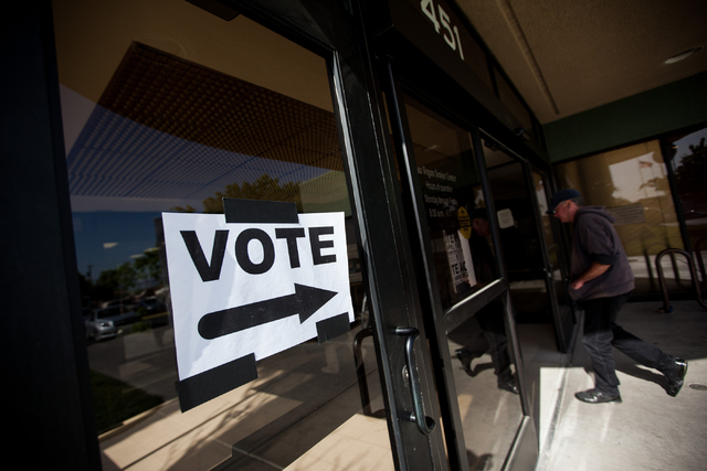 A sign directing people to the municipal election polling place inside the Las Vegas Senior Center is seen at 451 E. Bonanza Road in Las Vegas on Tuesday, April 7, 2015. (Chase Stevens/Las Vegas R ...