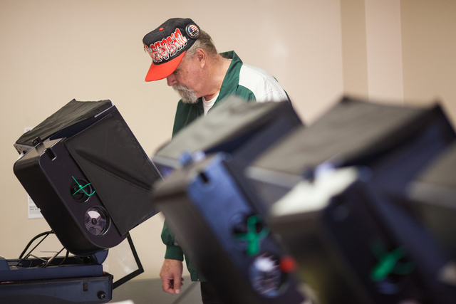 Don Bechard votes in the municipal election at the Las Vegas Senior Center at 451 E. Bonanza Road in Las Vegas on Tuesday, April 7, 2015. (Chase Stevens/Las Vegas Review-Journal)