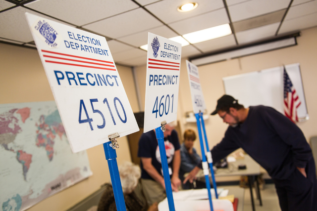 B. Oliver, right, checks in to vote in the municipal election at the Las Vegas Senior Center at 451 E. Bonanza Road in Las Vegas on Tuesday, April 7, 2015. (Chase Stevens/Las Vegas Review-Journal)