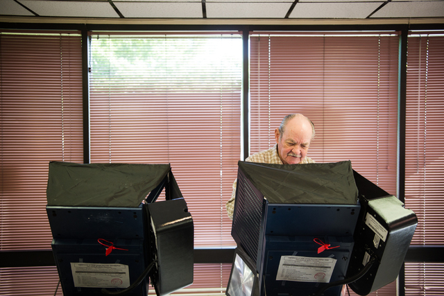 Glen Dunning votes in the municipal election at the Las Vegas Senior Center at 451 E. Bonanza Road in Las Vegas on Tuesday, April 7, 2015. (Chase Stevens/Las Vegas Review-Journal)