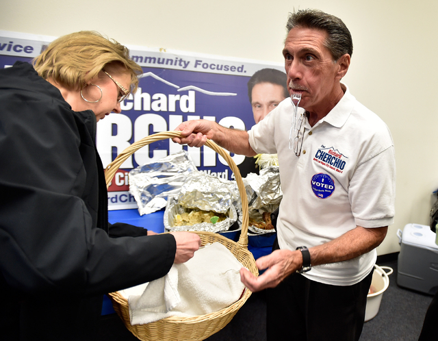 Richard Cherchio, right, holds a basket as a supporter unloads food during his election night party at his North Las Vegas campaign headquarters on Tuesday, April 7, 2015. Cherchio, who lost his l ...