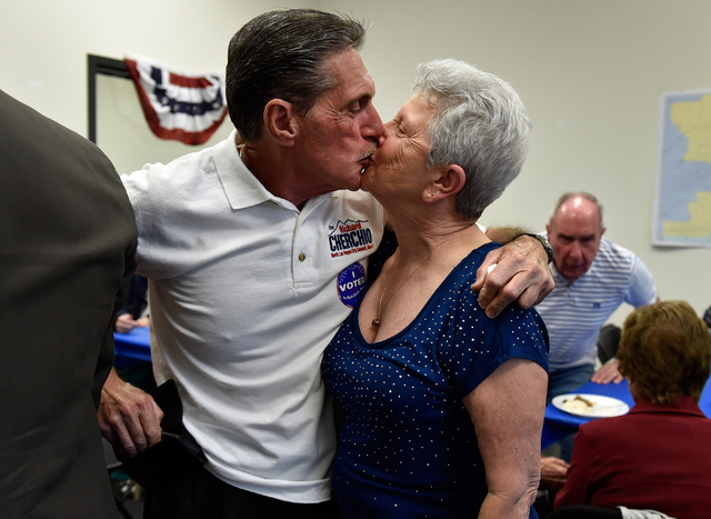 Richard Cherchio, left, and his wife, Gloria, embrace with a kiss during his election night party at his North Las Vegas campaign headquarters on Tuesday, April 7, 2015. Cherchio, who lost his las ...